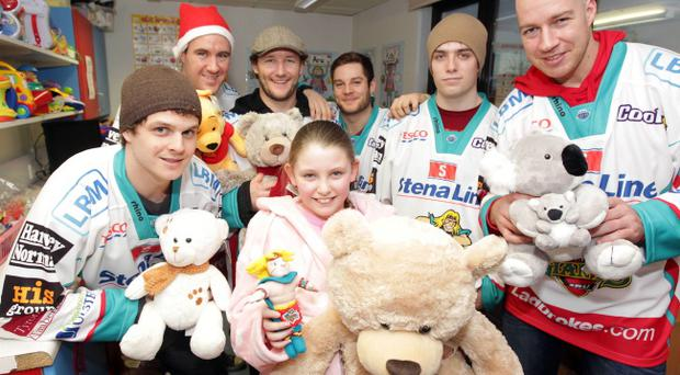Ten-year-old Kelsiy Magee receives a special Christmas present from Giants players Craig Peacock, Ryan Crane, Aaron Clarke, Robert Dowd, Mark Garside and Nick Kuiper