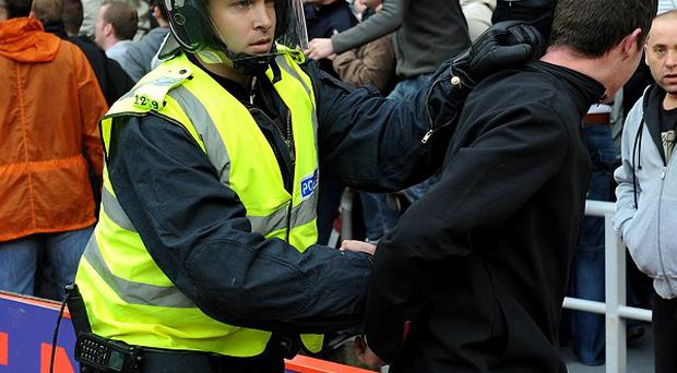 Arrests at football matches fell to a record low last season