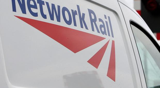 A Network Rail boss committed suicide with his wife after police were told he had taken bribes