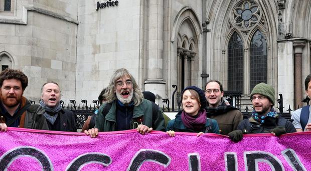Occupy London protesters on the steps of the High Court