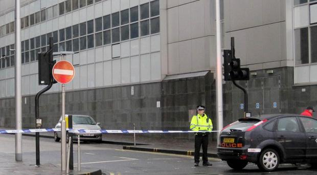 Police tape at the end of James Watt Street near Broomielaw in Glasgow, where two women were attacked in separate incidents