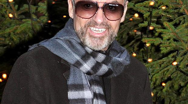George Michael gives a statement outside his home in Highgate, north London