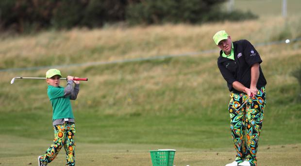 Like father, like son: John Daly and son John junior hard at work on practice range