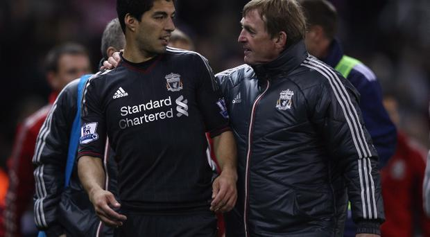 Luiz Suarez has full support of his manager, Kenny Dalglish but he fears abusive chants from opposition fans