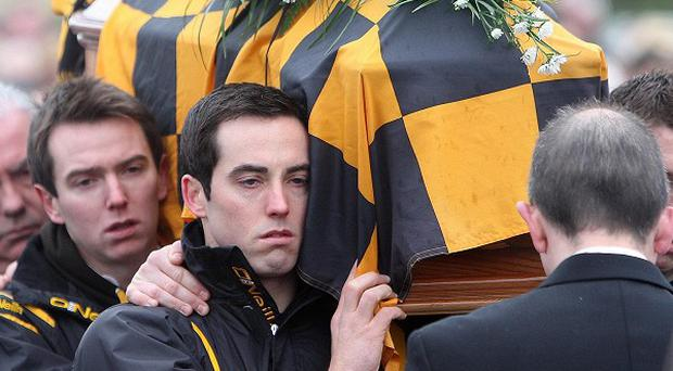 The coffin of murdered Crossmaglen GAA star James Hughes is carried through Crossmaglen, Co Armagh