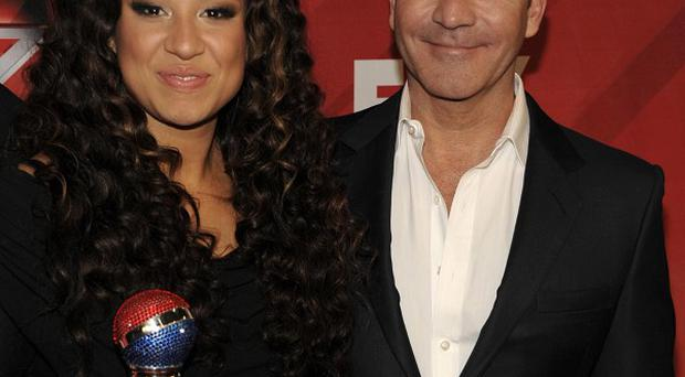 Melanie Amaro was chosen as winner of the first season of Simon Cowell's show