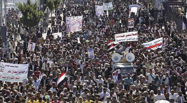 Protesters march during a demonstration demanding the prosecution of president Ali Abdullah Saleh in Sanaa (AP)