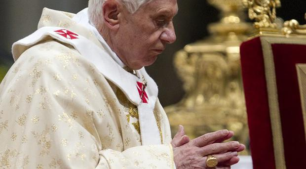 Pope Benedict XVI arrives to celebrate Christmas Mass in St. Peter's Basilica at the Vatican (AP Photo)