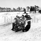 Theres more ways than one to take advantage of the snowy slopes, as these youngsters at Helens Bay golf club show, with their variety of descents, some prefer a solo effort, some two up, and even, at times as many as four. (16/02/1969)