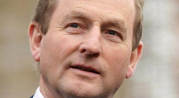 Enda Kenny is to write up report cards on his government ministers