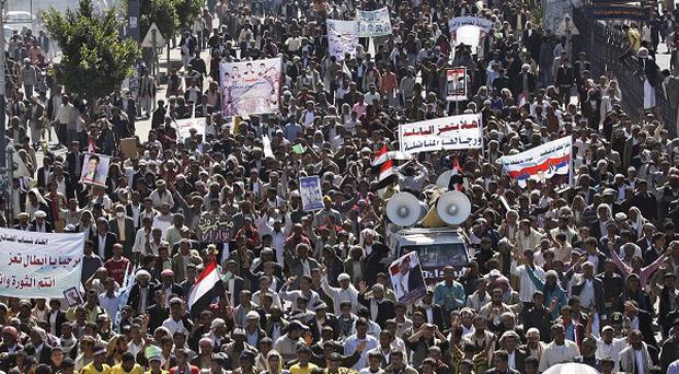 Protesters march during a demonstration demanding the prosecution of Yemen's President Ali Abdullah Saleh in Sanaa (AP)