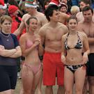 Swimmers take part in The Annual Boxing Day Swim in aid of Sparks NI at Ballyholme Bay, Bangor