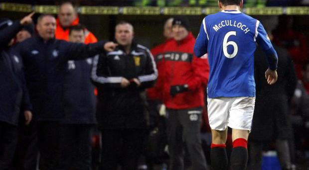 Rangers' Lee McCulloch walks off the pitch after receiving a red card during the Clydesdale Bank Scottish Premier League match at St Mirren Park, Paisley.
