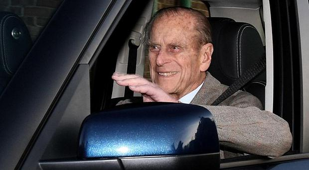 The Duke of Edinburgh smiles and waves as he leaves Papworth Hospital, near Cambridge, after undergoing heart surgery to have a stent fitted