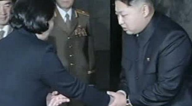 Kim Jong Un, right, shakes hands with Hyundai Group Chairwoman Hyun Jeong-eun in Pyongyang, North Korea (AP/APTN)