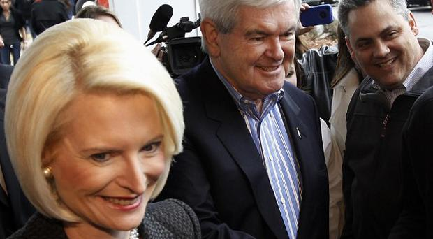Republican presidential candidate Newt Gingrich and his wife Callista campaign in Dubuque, Iowa (AP)
