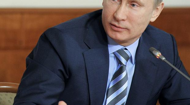 Russian prime minister Vladimir Putin has dimissed calls for a re-run of parliamentary elections (AP)