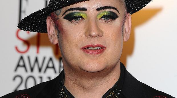 Singer Boy George has dismissed speculation he is joining reality TV show Celebrity Big Brother