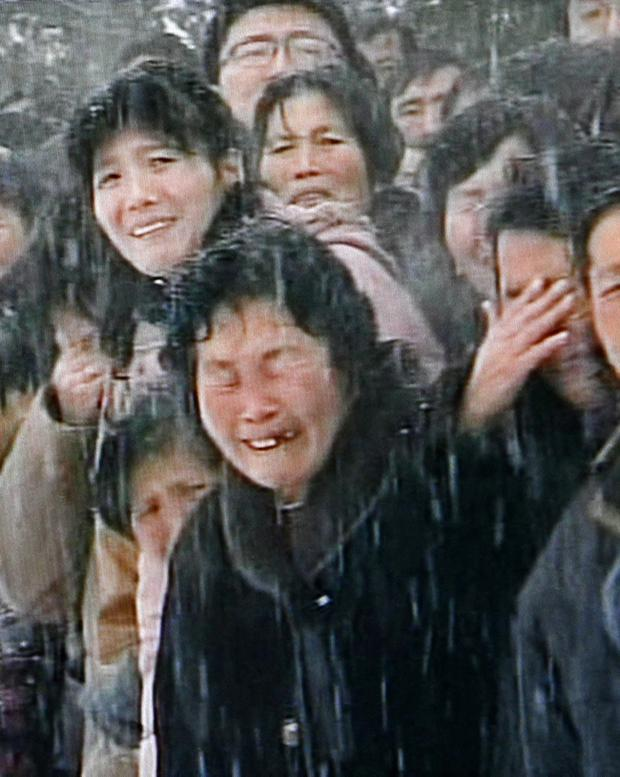 Scenes of public anguish amidst the falling snow during the funeral procession for North Korean leader Kim Jong Il in Pyongyang