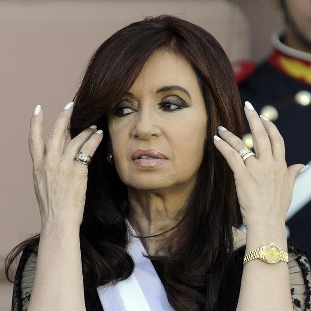 Argentina's president Cristina Fernandez is to undergo surgery to treat thyroid cancer (AP/Jorge Araujo)