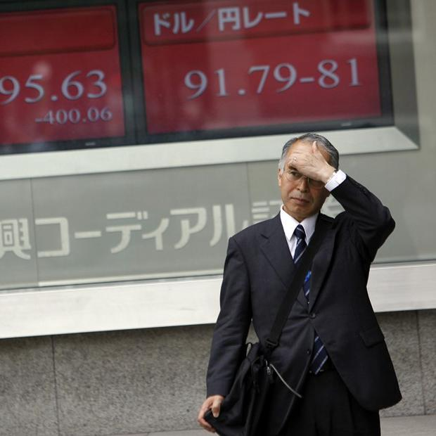 Japan's Nikkei 225 index fell marginally to 8,423 (AP)