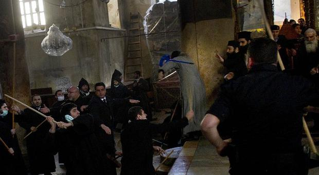 Armenian and Greek Orthodox clergymen scuffle inside the Church of the Nativity (AP)