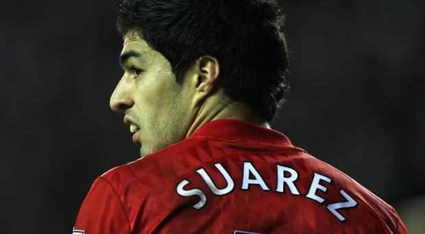 Red missed: Luis Suarez is out of the match against Newcastle