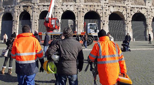 Experts check on the Rome's Colosseum after reports that bits of rock have fallen in the last days (AP/Mauro Scrobogna,Lapresse)