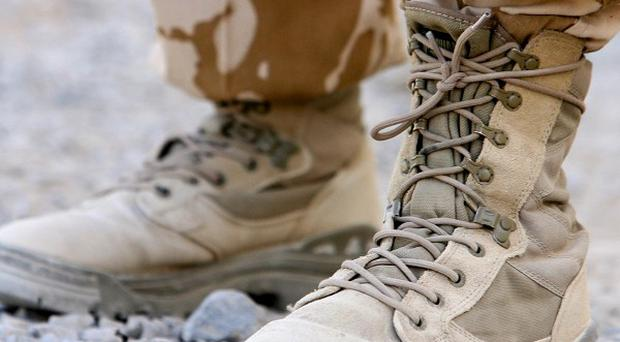 Two Nato service members have been killed in Afghanistan by a man wearing an Afghan army uniform