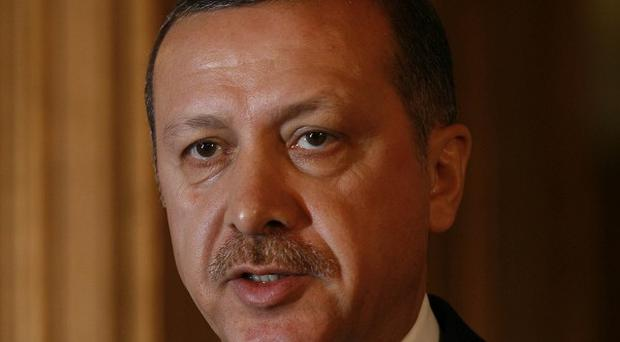 Turkish PM Recep Erdogan's ruling party said 35 smugglers have been killed in an air strike in Iraq