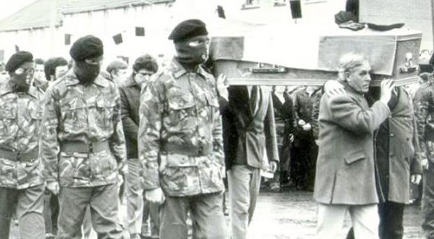 Hunger striker Bobby Sands' coffin, flanked by an IRA colour party, leaving his mother's home in Twinbrook.