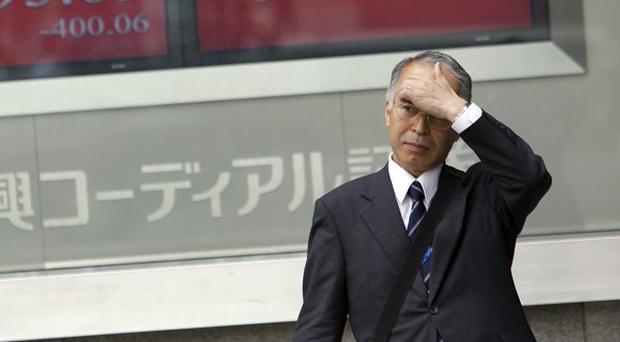 Japan's Nikkei 225 index has risen after three straight days of losses (AP)