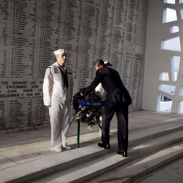 President Barack Obama lays a wreath at the USS Arizona Memorial, in Pearl Harbor, Hawaii (AP/Carolyn Kaster)