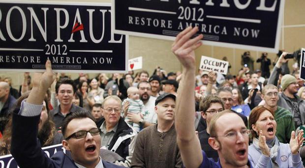Supporters cheer for Republican presidential candidate Ron Paul as he campaigns in Council Bluffs, Iowa (AP)