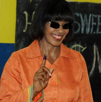 Preliminary results show Portia Simpson Miller will return to power in Jamaica (AP)
