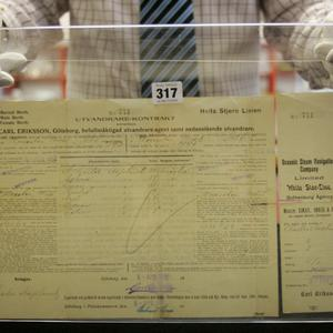 An emigration contract/ticket, purchased by the Asplund family for passage from Southampton to New York, and used on the Titanic, is seen at the Henry Aldridge and Son auctioneers in Devizes, Wiltshire, England Thursday, April 3, 2008. The locket and one of the rings were recovered from the body of Carl Asplund who drowned on the Titanic, they are all part of the Lillian Asplund collection of Titanic related items.