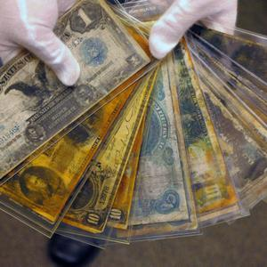 Currency, part of the artifacts collection of the Titanic, is shown as part of the artifacts collection at a warehouse in Atlanta, Friday, Aug 15, 2008. The 5,500-piece collection contains almost everything recovered from the wreckage of the RMS Titanic, which has sat 2.5 miles below the surface of the Atlantic ocean since the boat sank on April 15, 1912.