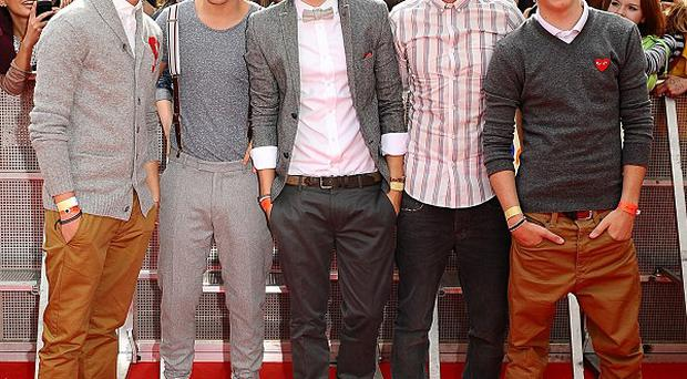 One Direction's Zayn Malik (far left) was caught doing some naked dancing, according to his bandmate