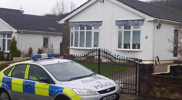 Police outside the home of Barry and Kath Haberfield, who were found dead two days after Christmas