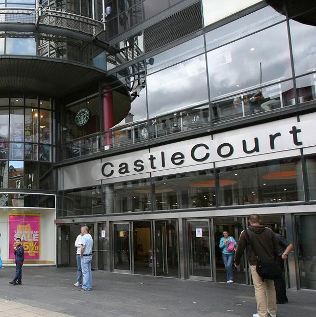 A man allegedly armed with a shotgun has been arrested in Castle Court shopping centre, Belfast