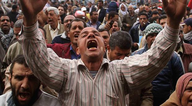 Britain has expressed concerns over reports of raids in Egypt as tensions reportedly increase between protesters and soldiers (AP)