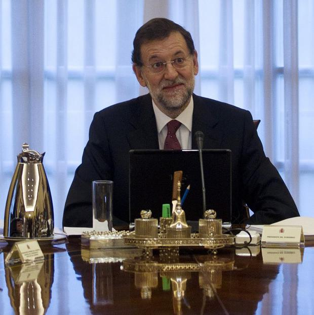 Prime Minister Mariano Rajoy's government is introducing austerity measures it tries to avoid a debt crisis (AP)