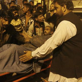 A man injured in the bombing arrives at a hospital in Quetta (AP)