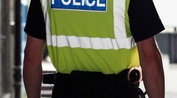 A woman has been arrest over the death of a man found in a Suffolk house