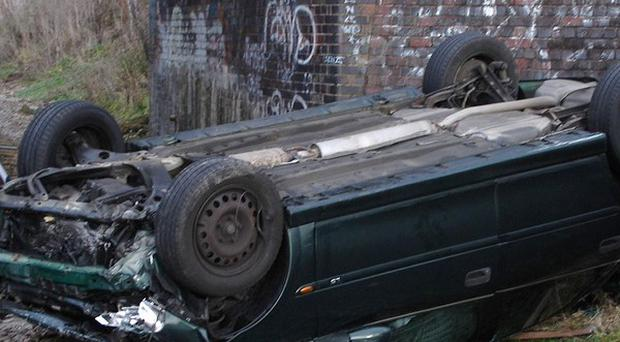 A car after it crashed through a railway bridge on to the track below in front of an on-coming steam train (Gloucestershire Fire and Rescue Service/PA)