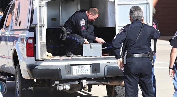 Security officers with an explosives transport box at the Midland International Airport in Midland, Texas (AP)