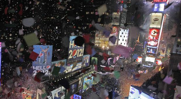 Confetti flies over New York's Times Square as the clock strikes midnight during the New Year's Eve celebration (AP)