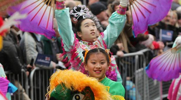 Members of Fairfax Chinese Dance Troupe take part in the New Year's Day parade in London