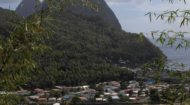 A British woman died after plunging from the top of a Caribbean clifftop on Christmas Day