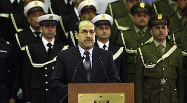 Iraqi prime minister Nouri al-Maliki warned Iraqis against 'excessive joy' over the departure of American troops (AP)